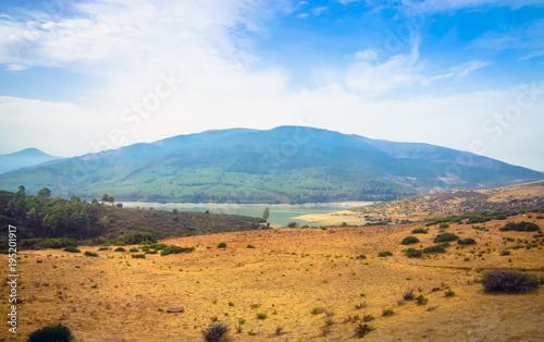 Staande foto Tunesië Desert road with Atlas Mountains, Morocco