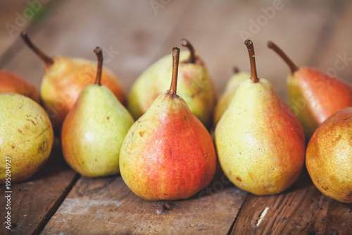 Several ripe pears lie on boards