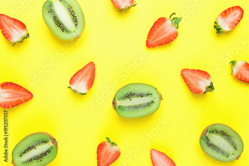 Ripe Organic Halved Strawberries and Kiwis Scattered on Bright Yellow Background in Pattern. Vibrant Colors Sunny Atmosphere. Flat Lay Arrangement. Summer Detox Clean Eating Vitamins Concept