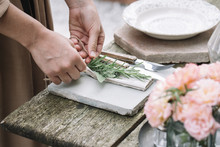Woman Decorating Napkin With F...