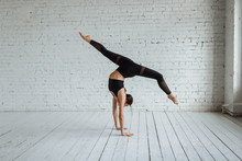 Beautiful Young Woman Working Out, Yoga, Pilates, Fitness Training, Doing A Handstand