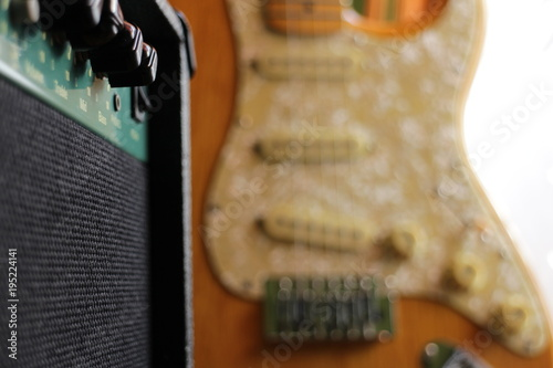 Photo  vintage stratocaster electric guitar with amplifier, blurred soft background for