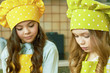 canvas print picture - Little girls preparing food. Kids in chef hats.