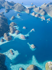 Aerial View of Calm Lagoon and Rock Islands in Raja Ampat