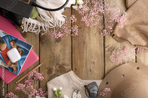 Free space for for notes and text, pink flowers on a wooden background. Card. Fashion accessories