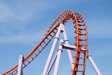 Roller Coaster On Blue Sky Background.