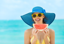 Happy Young Attractive Girl On The Beach Eating Watermelon.