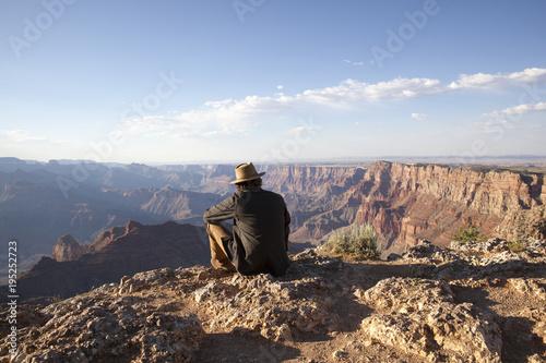 Man Sitting At Grand Canyon