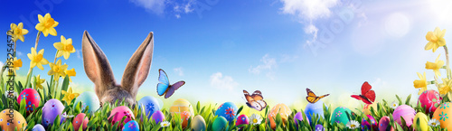 Stampa su Tela Easter - Bunny And Decorated Eggs In Flowery Field