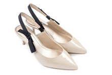 Women's Kitten Heel Dress Shoes In Beige Color Decorated With Black Bow Isolated On White