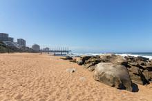 Beach Sand Rocks Ocean Waves Blue Coastal City Skyline