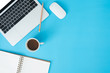 canvas print picture Minimal work space - Creative flat lay photo of workspace desk. Top view office desk with laptop, notebooks and coffee cup on blue color background. Top view with copy space, flat lay photography.