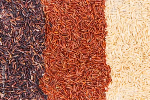 Heap of brown, black and red rice as background, healthy, gluten free nutrition Fototapeta
