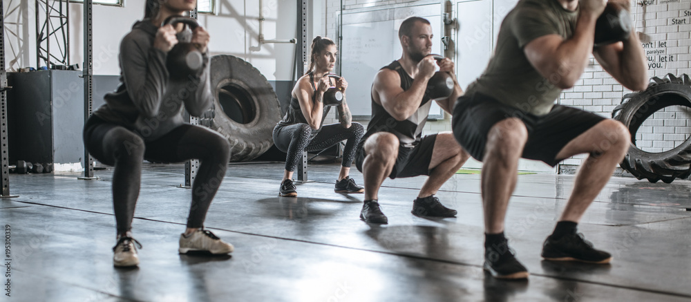 Fototapety, obrazy: People exercising with weights
