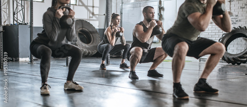 Keuken foto achterwand Fitness People exercising with weights