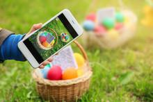 Little Boy Scanning QR Code In Basket With Colorful Eggs At Park. Easter Hunt Concept