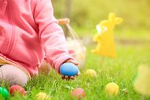 Little Girl Gathering Colorful Egg In Park. Easter Hunt Concept