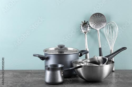 Valokuva  Metal cooking utensils on table