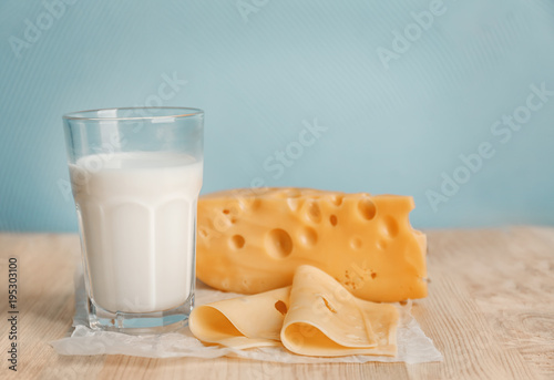 Glass of milk and cheese on table. Fresh dairy products