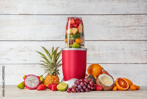 Smoothie maker mixer with pieces of fruit ingredients