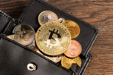 Golden Bitcoin Crypto Currency Coin On Euro Coins In Leather Wallet On Wooden Background