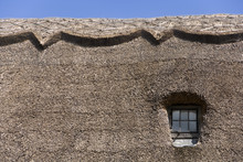 Semi-abstract Thatched Roof An...