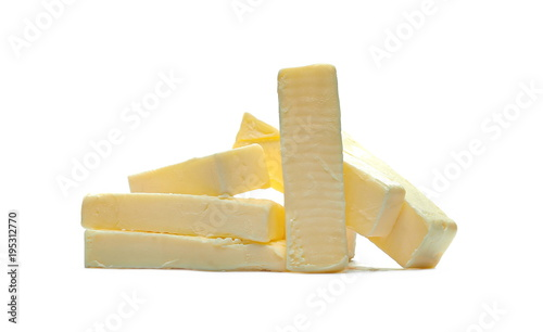 Staande foto Zuivelproducten Yellow butter pieces isolated on white background