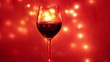 A glass of red wine moves in front of a red background with lights