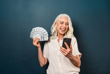 Mature Happy Old Woman Holding...