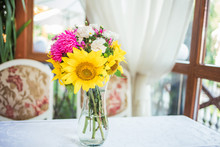 A Bouquet Of Sunflowers And As...