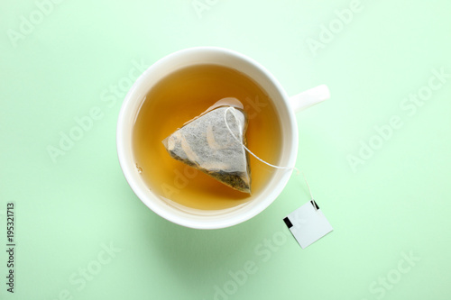 Mint tea bag in a cup