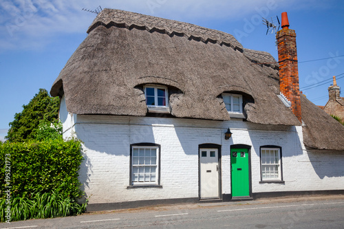 Traditional white english thatched house in Southern England UK