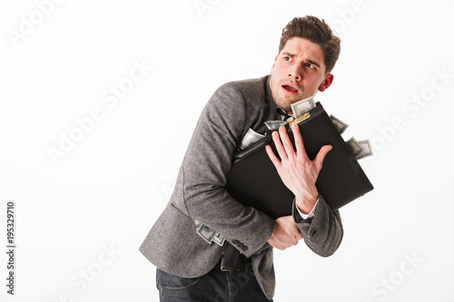 Fotografie, Obraz Portrait of a terrified young businessman