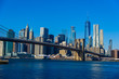 Lower Manhattan Downtown skyline panorama from Brooklyn Bridge Park riverbank, New York City, USA