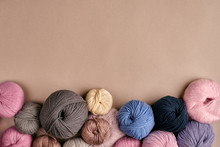 Set Of Colorful Wool Yarn On Beige Background. Top View
