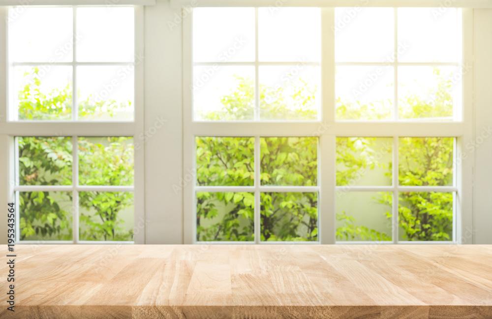 Fototapeta Top of wood table counter on blur window view garden background.