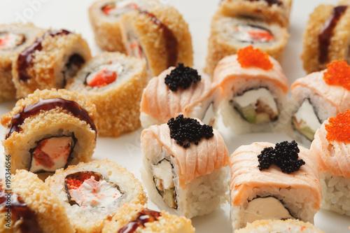 Deurstickers Klaar gerecht Closeup of sushi rolls on white background