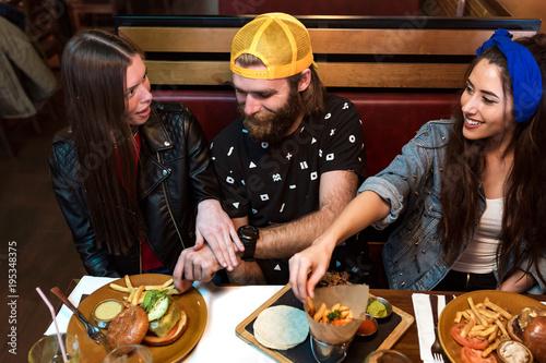 People tasting food in restaurant