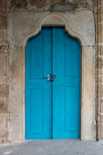 Blue Door Of A Monastery, The Color Of The Wood Playing Nicely With The Color Of The Sandstone Wall