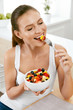 Healthy Food. Happy Woman Eating Salad With Fruits.