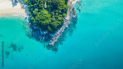 Aerial view Tropical island with white sand beach and blue clear water and granite stones. Top view of coral reef, Phuket, Thailand.