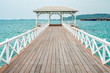 The bridge built go to the sea, beautiful wood bridge background is blue ocean at the summer.