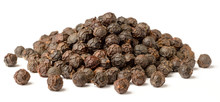 Close Up Of Dried Black Peppercorns Isolated On White