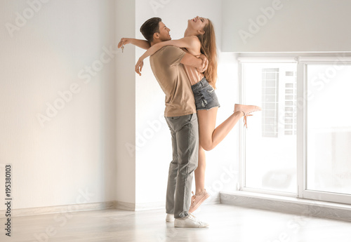 Fotografie, Obraz  Young couple dancing in their new house