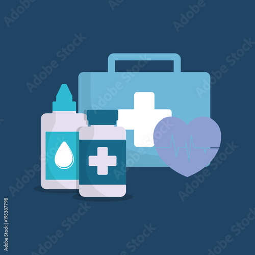 First aid kit and medicine bottles over blue background