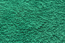 Abstract Background Of Shaggy Green Carpet Pile. Cloth Texture With Long Fibers