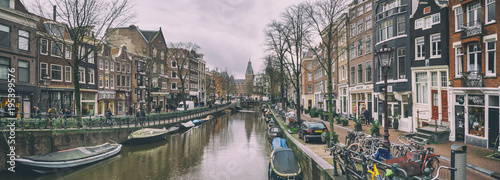 Obraz Cityscape, panorama - view of city channel with boats, city of Amsterdam, The Netherlands. - fototapety do salonu