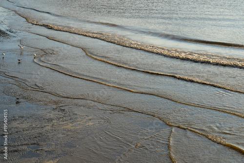 Fotografija  wellen an der Elbküste in hamburg