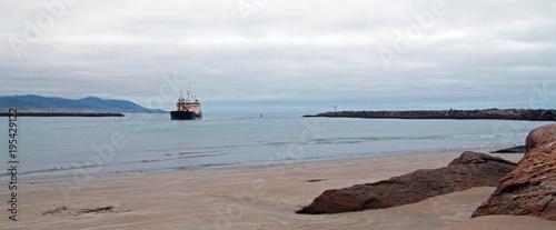 Fotografia, Obraz  Dredging ship in Morro Bay harbor on the central coast of California United Stat
