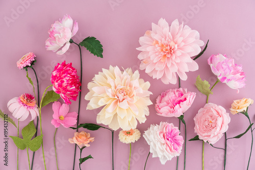 Canvas Prints Dahlia Crepe paper flowers on pink wooden background